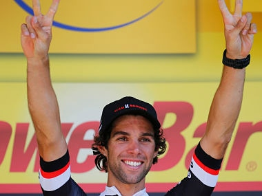 Stage winner Australia's Michael Matthews celebrates on the podium after the sixteenth stage of the Tour de France cycling race over 165 kilometers (102.5 miles) with start in Le Puy-en-Velay and finish in Romans-sur-Isere, France, Tuesday, July 18, 2017. (AP Photo/Peter Dejong)