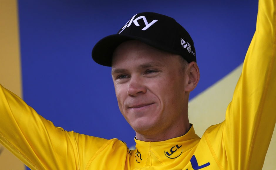 Britain's Chris Froome, wearing the overall leader's yellow jersey celebrates on the podium after the tenth stage of the Tour de France cycling race over 178 kilometers (110.6 miles) with start in Perigueux and finish in Bergerac, France. AP