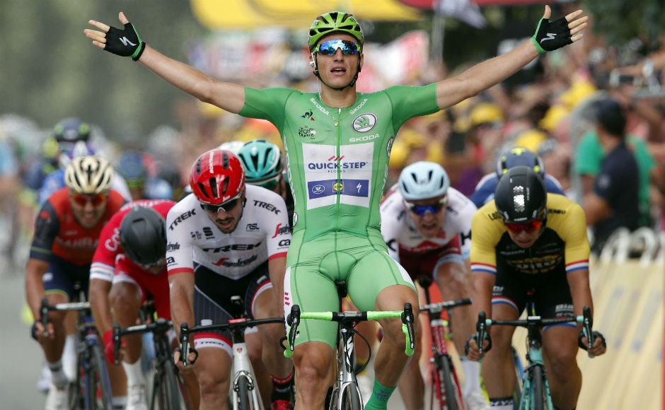 Germany's Marcel Kittel, wearing the best sprinter's green jersey celebrates as he crosses the finish line to win the tenth stage of the Tour de France cycling race over 178 kilometers (110.6 miles) with start in Perigueux and finish in Bergerac. AP