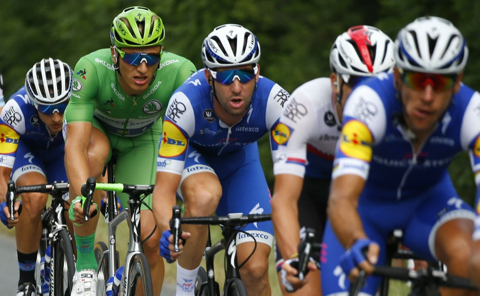 Teammates set the pace for stage winner Germany's sprinter Marcel Kittel, wearing the best sprinter's green jersey, at the front of the pack during the tenth stage of the Tour de France cycling race over 178 kilometers (110.6 miles) with start in Perigueux and finish in Bergerac. AP
