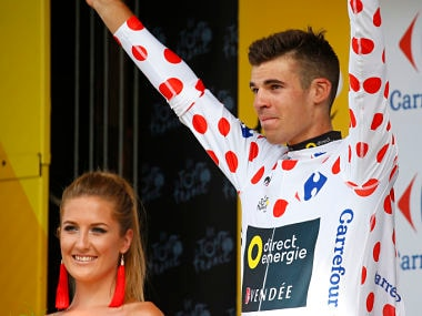 France's Lilian Calmejane, wearing the best climber's dotted jersey, celebrates on the podium after the eighth stage of the Tour de France cycling race over 187.5 kilometers (116.5 miles) with start in Dole and finish in Station des Rousses, France, Saturday, July 8, 2017. (AP Photo/Peter Dejong)