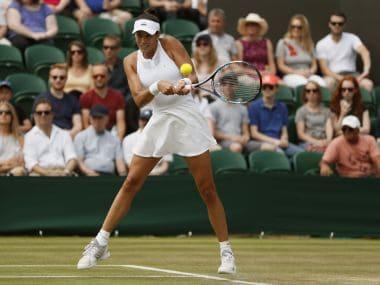 Spain's Garbine Muguruza returns to Romania's Sorana Cirstea during their Women's Singles Match on day six at the Wimbledon Tennis Championships in London Saturday, July 8, 2017. (AP Photo/Kirsty Wigglesworth)