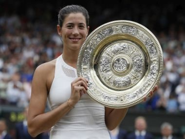 Spain's Garbine Muguruza holds the trophy after defeating Venus Williams of the United States in the Women's Singles final match on day twelve at the Wimbledon Tennis Championships in London Saturday, July 15, 2017. (AP Photo/Kirsty Wigglesworth)