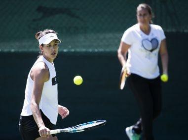 Garbine Muguruza and her coach Conchita Martinez during a training session. AP