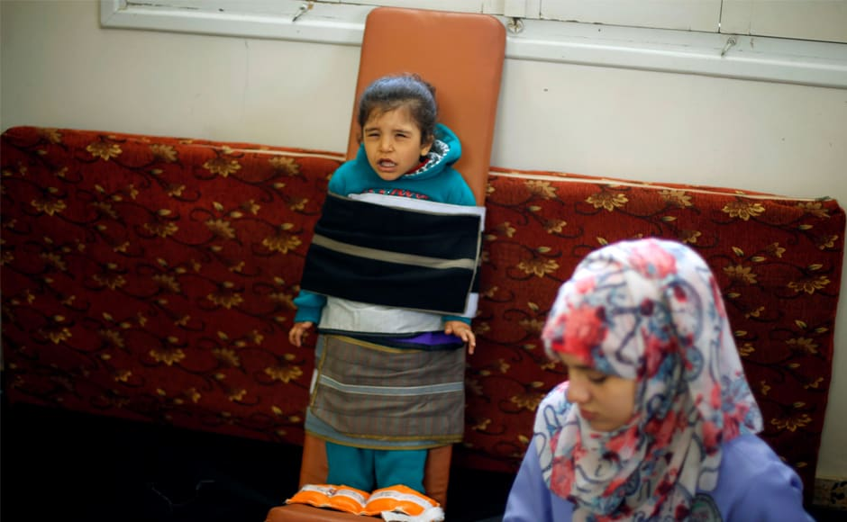 Palestinian girl Rasha al-Bayed, 5, who suffers from cerebral palsy, attends a physiotherapy session at Mabaret Falasteen charity in Gaza City. Without fuel, 40 surgical operation theatres, 11 obstetric operation theatres, 5 haemodialysis centres and hospital emergency departments serving almost 4,000 patients daily will be forced to stop critical services. Reuters