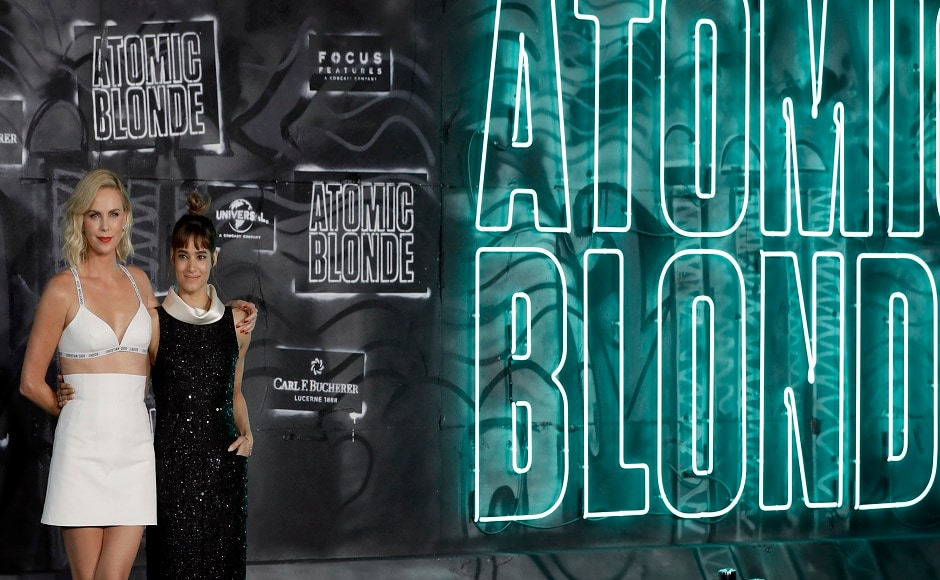 Actress Charlize Theron (left) and actress Sofia Boutella (right) pose for the media as they arrive for the world premiere of the movie Atomic Blonde in Berlin, Germany, Monday, 17 July, 2017. Image via AP/Michael Sohn