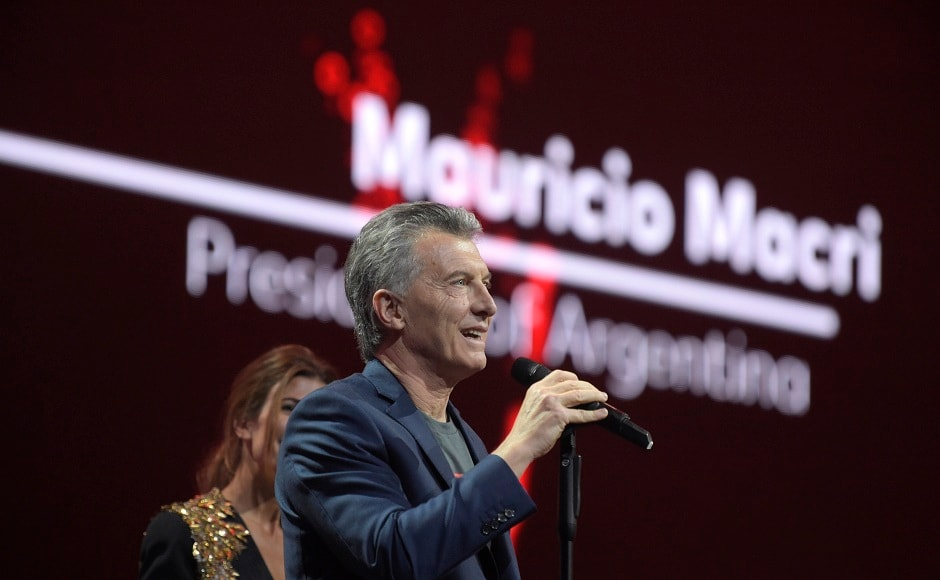 Argentinian President Mauricio Macri speaks to the crowd during the Global Citizen Festival concert on the eve of the G-20 summit in Hamburg, northern Germany, Thursday, July 6, 2017. The leaders of the group of 20 meet July 7 and 8. (AP Photo/Jens Meyer)