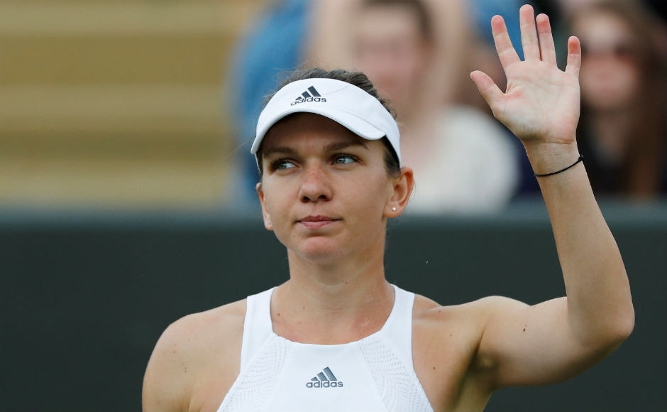 No. 2 seed Simona Halep waves to the crowd after winning 6-4, 6-1 against New Zealand's Marina Erakovic in the 1st round of Wimbledon. Reuters