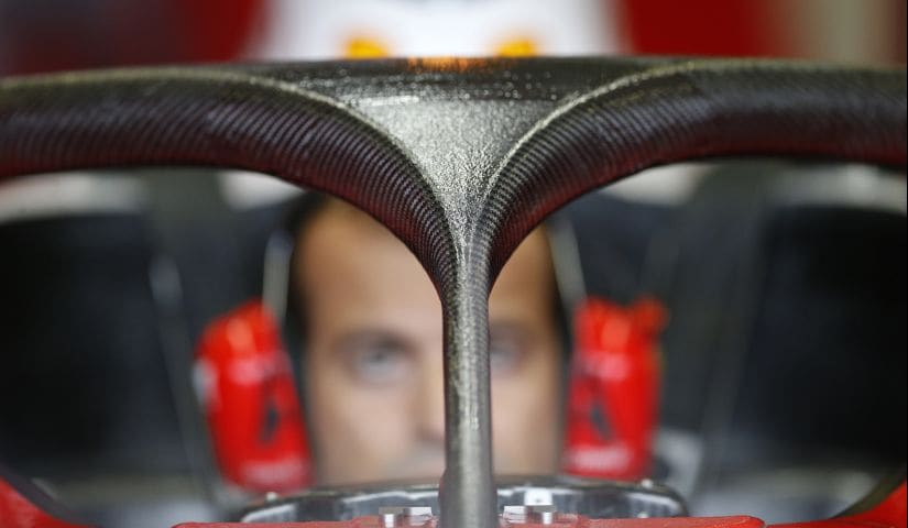 A Ferrari mechanic with the Halo safety device during practice. Reuters