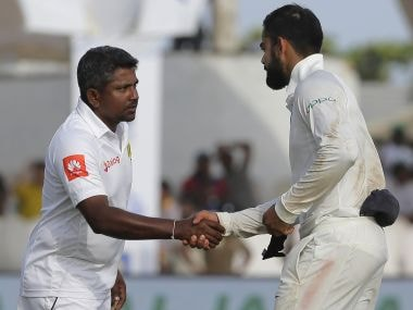 India's captain Virat Kohli, right, shakes hands with Sri Lankan captain Rangana Herath after their win in the first test cricket match in Galle, Sri Lanka, Saturday, July 29, 2017. Indian won the match by 304 runs. (AP Photo/Eranga Jayawardena)