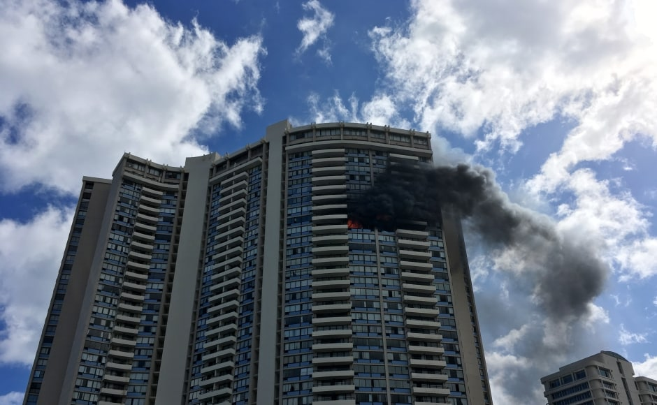 Flames ripped through three floors of a Honolulu tower block, killing three people including a mother and her son on Friday. The blaze at the 36-story Marco Polo condominium complex sent thick black smoke pouring over the city. AP