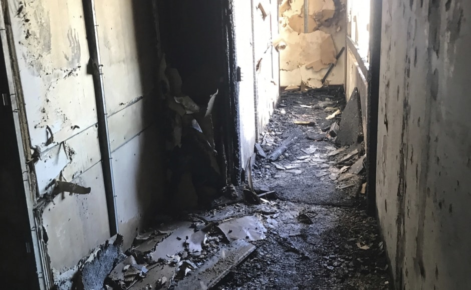 """Fire chief Manuel Neves told reporters that the building did not have a sprinkler system. More than 100 firefighters tackled the fire and officers were conducting a room-by-room search, a task that could take several hours, he said. """"We don't have any information for us to believe that there are problems with the structure,"""" Neves added. AP"""