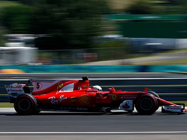 Ferrari driver Sebastian Vettel steers his car during the third free practice session for the Hungarian Formula One Grand Prix. AP