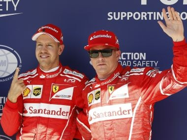 Ferrari drivers Sebastian Vettel of Germany, left, and Kimi Raikkonen of Finland pose for photos at the end of the qualifying session for the Hungarian Formula One Grand Prix, at the Hungaroring racetrack in Mogyorod, northeast of Budapest, Saturday, July 29, 2017. The Hungarian Grand Prix will be held on Sunday, July 30. Vettel clocked the fastest time and Raikkonen was second. (AP Photo/Darko Bandic)