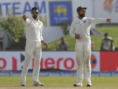 India's Virat Kohli, right, and Ravindra Jadeja set the field during the first Test. AP