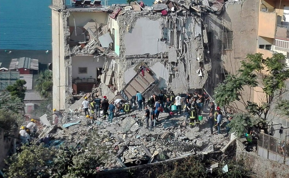The structure collapsed partially and the interiors of some the apartments were visible. AP