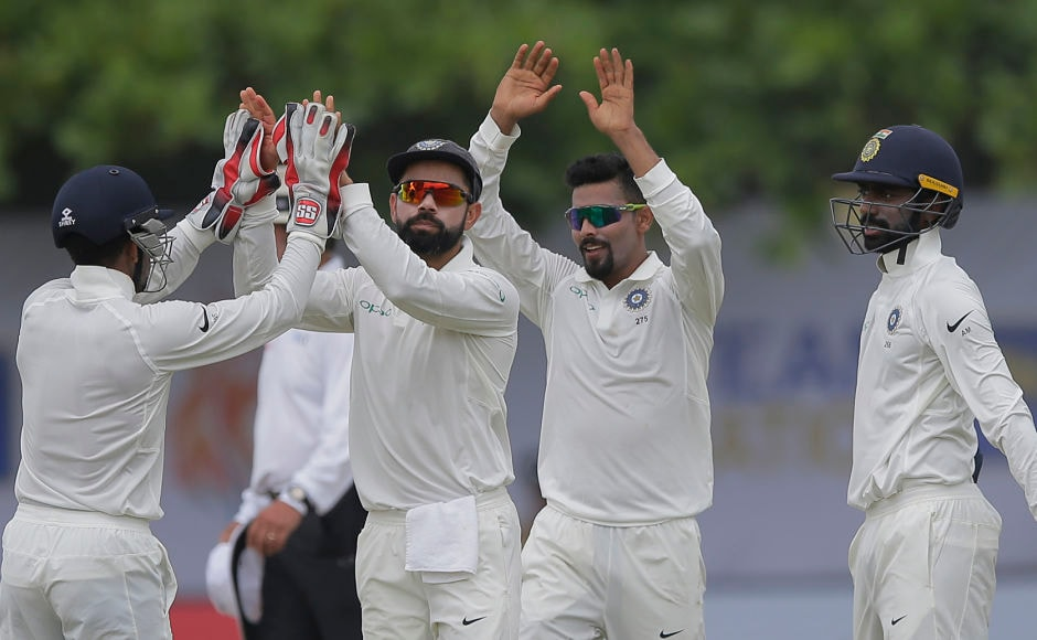 India's captain Virat Kohli and Abhinav Mukund celebrate with Ravindra Jadeja after the bowler dismissed former Sri Lanka captain Angelo Mathews. AP