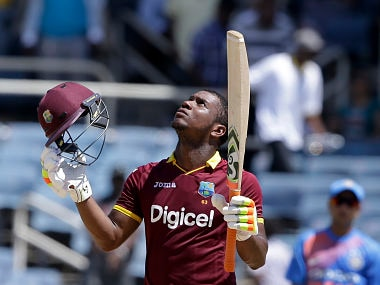 West Indies' Evin Lewis celebrates at the end of a T20I against India at Sabina Park cricket ground in Kingston, Jamaica, Sunday, July 9, 2017. West Indies won by nine wickets and Lewis scored 125 runs. (AP Photo/Ricardo Mazalan)