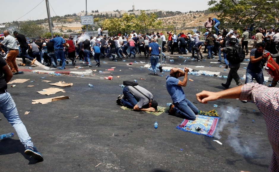 Two Palestinians died in clashes with Israeli forces as the army moved in to seal off an attacker's home after violence over security measures at an ultra-sensitive holy site. Reuters