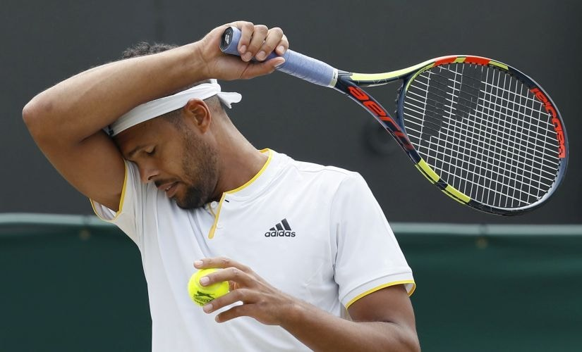 Jo—Wilfried Tsonga of France wipes his brow as he plays Sam Querrey of the United States during their Men's Singles Match on day six at the Wimbledon Tennis Championships in London Saturday, July 8, 2017. (AP Photo/Kirsty Wigglesworth)