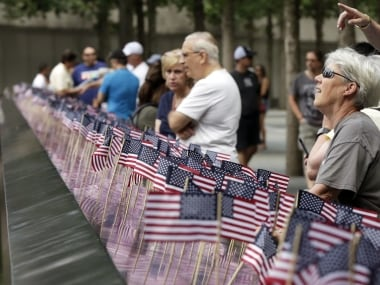 People at the 9/11 Memorial in New York on 4 July. AP