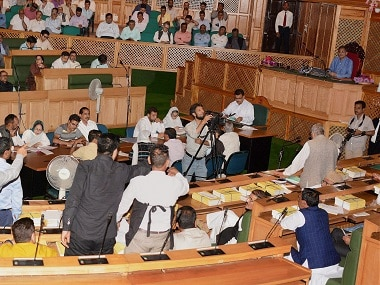 Opposition MLA's shout slogans inside Jammu and Kashmir Legislative Assembly during a debate on Goods and Services Tax. PTI