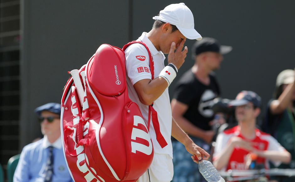 Ninth-seeded Kei Nishikori of Japan was eliminated by Spaniard Roberto Bautista Agut in Round 3. Reuters