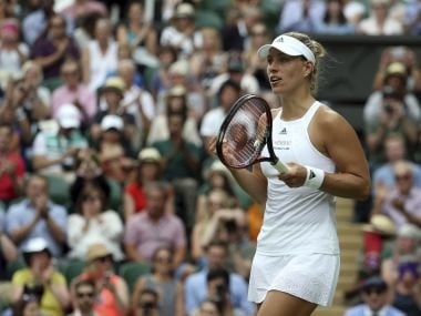 Germany's Angelique Kerber celebrates after winning her Women's Singles Match against Irina Falconi of the United States on day two at the Wimbledon Tennis Championships in London Tuesday, July 4, 2017. (AP Photo/Alastair Grant)