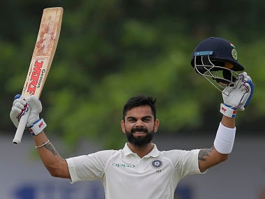 Indian cricket captain Virat Kohli celebrates scoring a century during the fourth day's play. AP