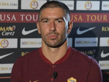 Aleksandar Kolarov poses after completing a permanent move to AS Roma from Manchester City. Twitter: @ASRomaEN