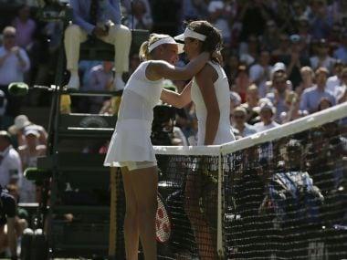 Britain's Johanna Konta, right, hugs Croatia's Donna Vekic after winning their Women's Singles Match on day three at the Wimbledon Tennis Championships in London Wednesday, July 5, 2017. (AP Photo/Tim Ireland)