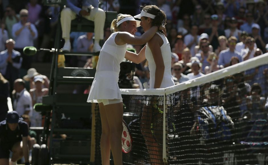 Britain's Johanna Konta (R) hugs Croatia's Donna Vekic (L) after her marathon win left her 21-year-old opponent in tears. AP