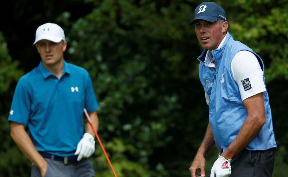 Jordan Spieth and Matt Kuchar stand on the fifth tee during the final round. Spieth began the day with a three-stroke lead but saw that evaporate on the front nine, where he made four bogeys and a birdie to enter the turn sharing the lead with Kuchar on eight-under.