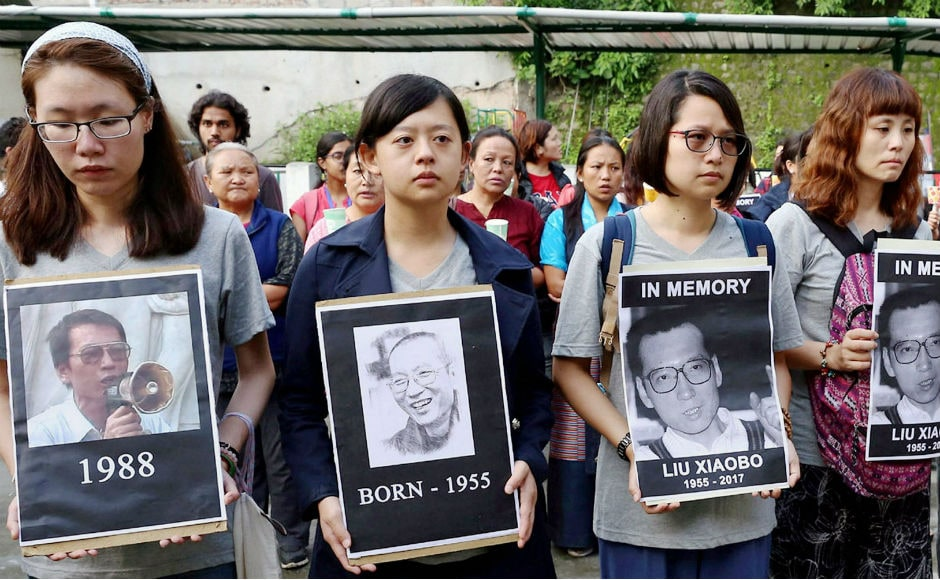 Tibetans living in exile in Himachal Pradesh's McLeodganj carried out a candlelight vigil in the momory of Liu Xiaobo, who died on Thursday. PTI