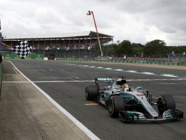 Mercedes driver Lewis Hamilton of Britain crosses the finish line to win the British Formula One Grand Prix at the Silverstone racetrack in Silverstone, England, Sunday, July 16, 2017. (AP Photo/Jason Cairnduff, Pool)