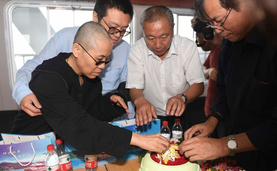 Liu's friends and family members bade him farewell in a private ceremony in North East China's Shenyang city. His wife prepared his ashes for burial at sea off the coast of Dalian in northeastern China's Liaoning Province. AP