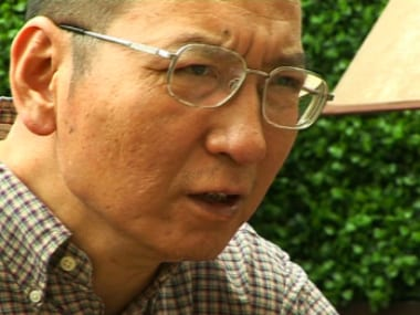 In this image taken from 3 June, 2008, video footage by AP Video, Liu Xiaobo speaks during an interview before his detention in Beijing, China.