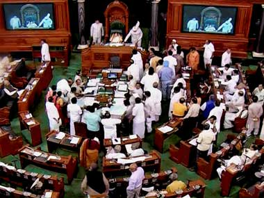 A view of the Lok Sabha as opposition members raise protest in the well of the House, during the Monsoon session at Parliament house in New Delhi on Thursday. PTI