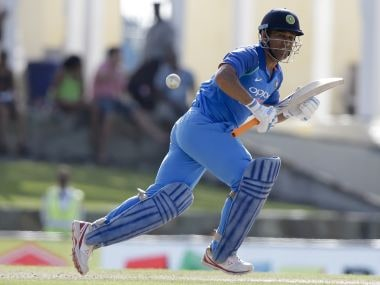 India's MS Dhoni plays a shot during the fourth ODI against Windies. AP