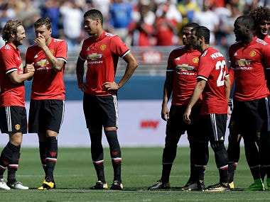 Manchester United's Daley Blind, left, celebrates after scoring during a shootout against Real Madrid in the second half of an international friendly soccer match, Sunday, July 23, 2017, in Santa Clara, Calif. (AP Photo/Ben Margot)