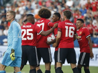 Manchester United players celebrate after Marcus Rashford scored his second goal of the game. AP