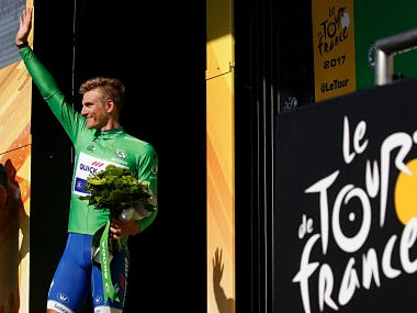 Marcel Kittel, wearing the best sprinter's green jersey, celebrates on the podium after the seventh stage of the Tour de France. AP
