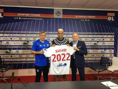 Mariano Diaz poses with his representatives after signing for Ligue 1 side Lyon. Twitter: @OL