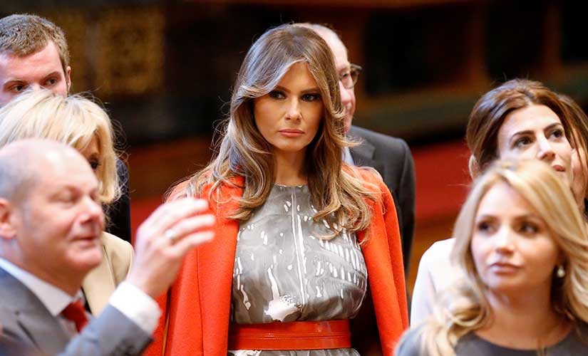 US First Lady Melania Trump stands next to Argentine President's wife Juliana Awada, Canadian prime minister's wife Sophie Gregoir-Trudeau as Hamburg mayor Olaf Scholz, left, speaks during the spouses program of the G20 summit at the townhall in Hamburg, Germany. AP