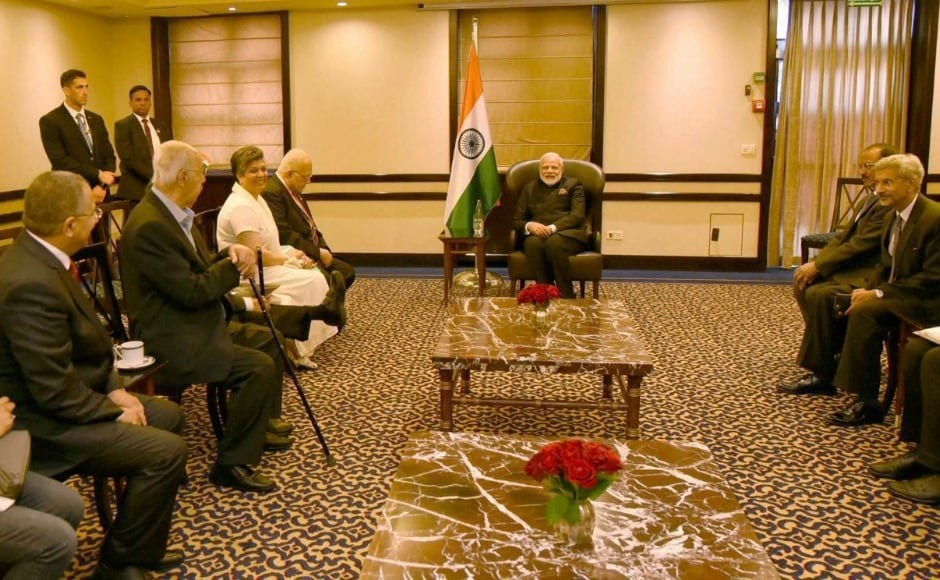 Narendra Modi and his delegation met recipients of the Pravasi Bharatiya Samman, an award instituted by the Indian government for Indians living abroad who achieve success in various fields. PTI