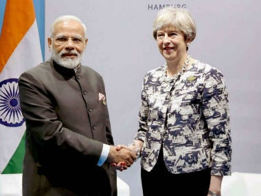 Prime Minister Narendra Modi meeting Theresa May. PTI