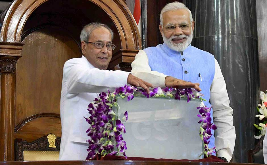 President Pranab Mukherjee, who piloted the first constitutional amendment for unifying more than a dozen central and state taxes, shared a specially erected dais in the Central Hall of Parliament. At the stroke of midnight, Mukherjee and Modi pressed two buttons on a glass box decorated with orchids and GST inscribed on it. PTI