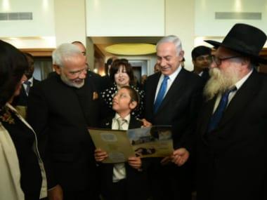 Narendra Modi with Moshe Holtzberg. Twitter/@MEAIndia