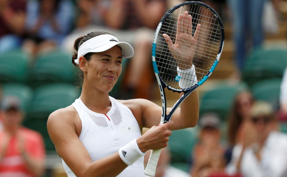 Garbine Muguruza reached the fourth round at Wimbledon, two years after making it all the way to the final. Reuters
