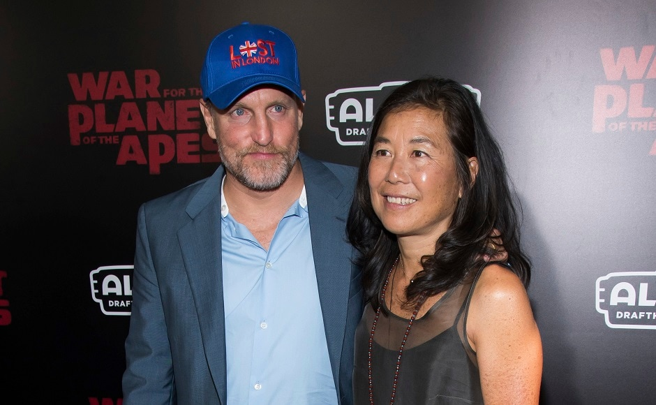 Woody Harrelson, who plays the antagonist, left, and his wife Laura Louie. Photo by AP